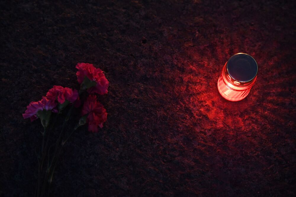 Candles and flowers at the Eternal Flame on Poklonnaya Hill in memory of those killed in the Great Patriotic War as part of the traditional Candle of Memory campaign in Moscow.