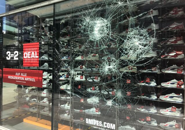 A smashed window is seen in Stuttgart's main shopping street after a group of looters smashed several windows in Stuttgart, Germany, June 21, 2020