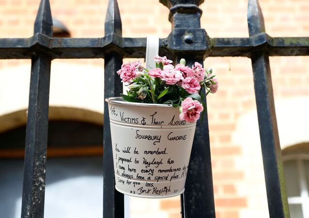 A view shows a floral tribute to the victims at the scene of multiple stabbings in Reading, Britain, June 21, 2020.