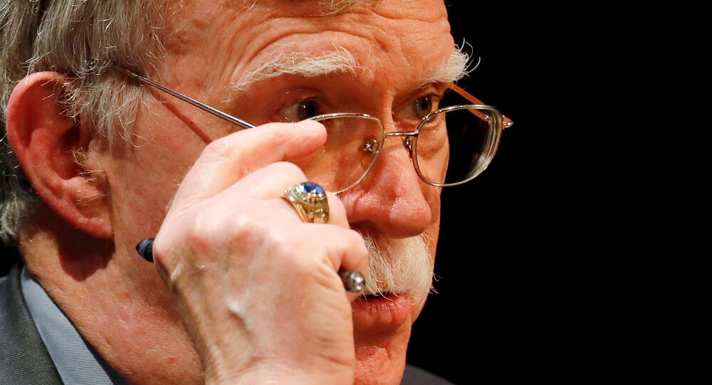 Former U.S. national security adviser John Bolton adjusts his glasses during his lecture at Duke University in Durham, North Carolina, U.S. February 17, 2020