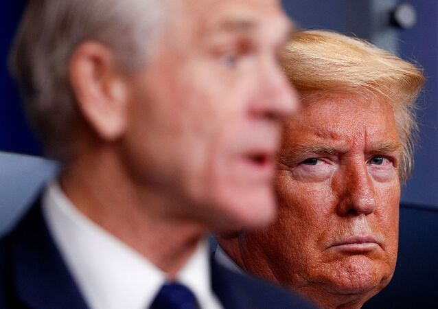 U.S. President Donald Trump listens as White House Director of Trade and Marketing Policy Peter Navarro addresses the daily coronavirus response briefing at the White House in Washington, U.S., April 2, 2020.