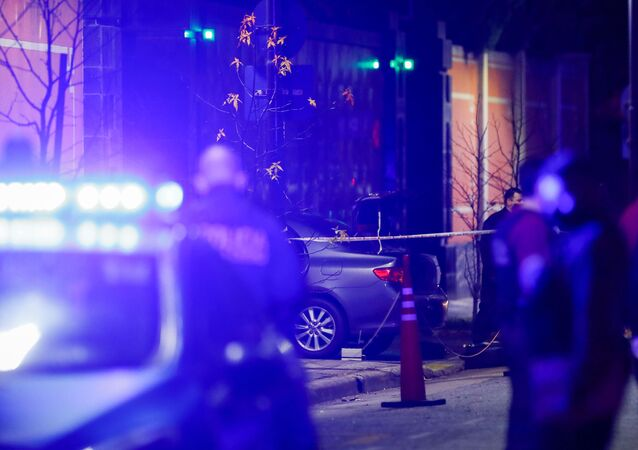 Police officers walk past a car which, according to local media, was crashed by a man into the exterior gate of the Chinese embassy in Buenos Aires, Argentina June 22, 2020.