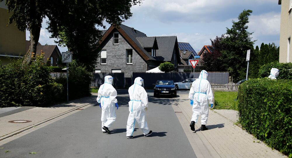 Members of a mobile testing unit of the German Army and German Red Cross arrive to test residents for the coronavirus disease (COVID-19), following an outbreak of the disease at Toennies meat factory, where employees remain under lockdown, in Guetersloh, Germany, June 22, 2020.