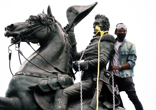 A protestors wraps chains and ropes around the statue of U.S. President Andrew Jackson during an attempt by protestors to pull the statue down in the middle of Lafayette Park in front of the White House during racial inequality protests in Washington, D.C., U.S., June 22, 2020