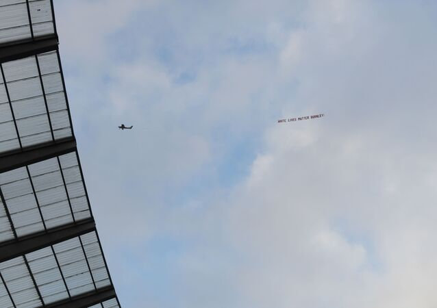 Soccer Football - Premier League - Manchester City v Burnley - Etihad Stadium, Manchester, Britain - June 22, 2020 A White Lives Matter Burnley sign is seen on a plane above the stadium , as play resumes behind closed doors following the outbreak of the coronavirus disease (COVID-19)