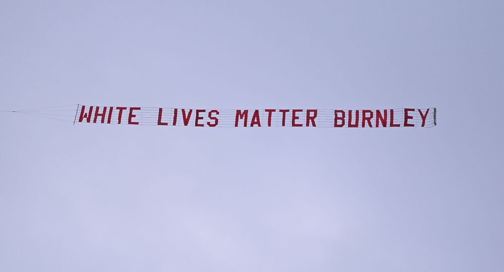 Soccer Football - Premier League - Manchester City v Burnley - Etihad Stadium, Manchester, Britain - June 22, 2020 A White Lives Matter Burnley banner is seen tied to a plane above the stadium, as play resumes behind closed doors following the outbreak of the coronavirus disease (COVID-19)