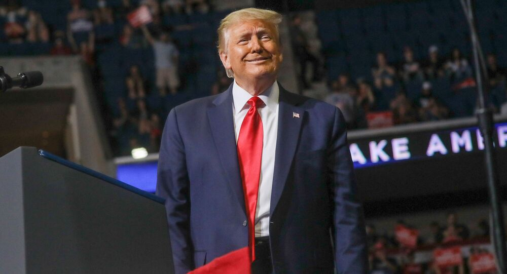 U.S. President Donald Trump smiles at the crowd as he arrives at the podium to speak during his first re-election campaign rally in several months in the midst of the coronavirus disease (COVID-19) outbreak, at the BOK Center in Tulsa, Oklahoma, U.S., June 20, 2020