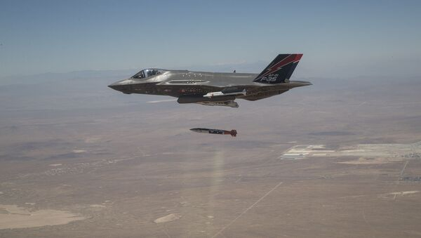 An F-35A releases ordnance during a dual capable aircraft (DCA) test flight in the skies above Edwards Air Force Base, California, on June 27, 2019. - Sputnik International