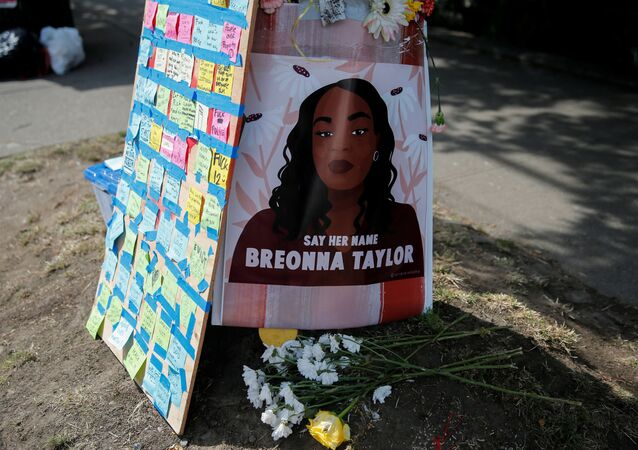 A portrait of Breonna Taylor is posted to a pole beside messages on sticky notes as protesters establish what they call an autonomous zone while continuing to protest against racial inequality and call for a defunding of Seattle police, in Seattle, Washington, U.S. June 10, 2020. REUTERS/Lindsey Wasson