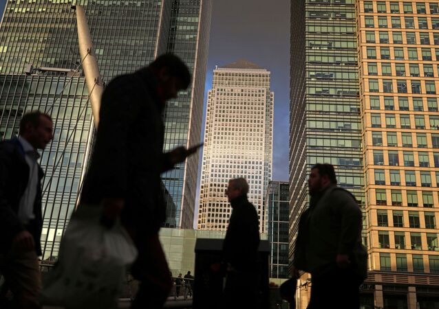 People walk through the Canary Wharf financial district of London, Britain, December 7, 2018