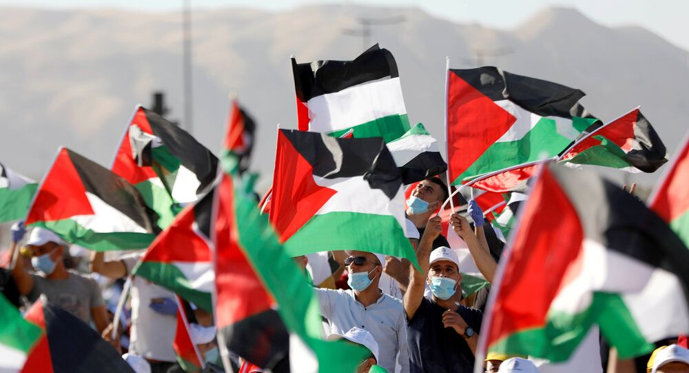 Demonstrators take part in a rally, organised by the Palestinian Liberation Organization (PLO), to protest against Israel's plan to annex parts of the occupied West Bank, in Jericho June 22, 2020
