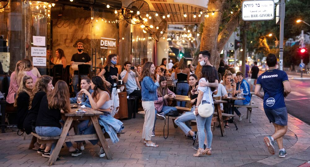 People enjoy themselves at a restaurant as some businesses reopened at the end of last month under a host of new rules, following weeks of shutdown amid the coronavirus disease (COVID-19) crisis, in Tel Aviv, Israel June 4, 2020. Picture taken June 4, 2020.
