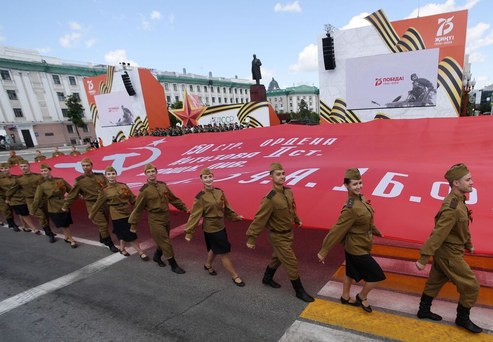 Actors march on Svobody Square in Kazan during the military parade to commemorate the 75th anniversary of Victory in World War II