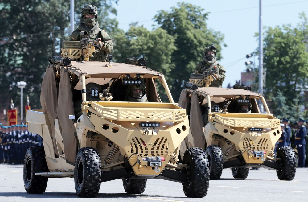 Tactical all-terrain vehicles of the Special Operations Force drive on Lenin Square in Tula during the military parade to commemorate the 75th anniversary of Victory in World War II