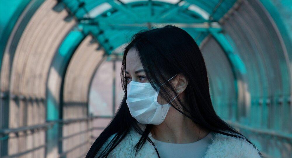 Asian woman wearing a mask