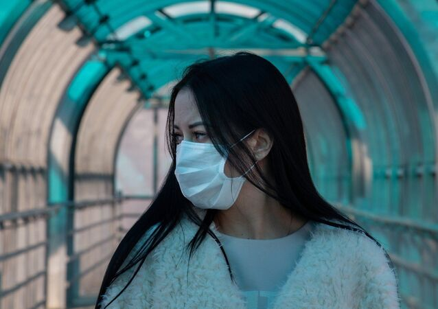 Asian woman wearing a mask