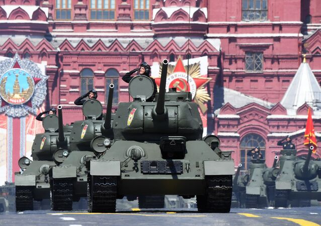 T-34 tanks (foreground) and SU-100 self-propelled tank destroyers at the military parade commemorating the 75th anniversary of Victory in the Great Patriotic War,  June 24, 2020.
