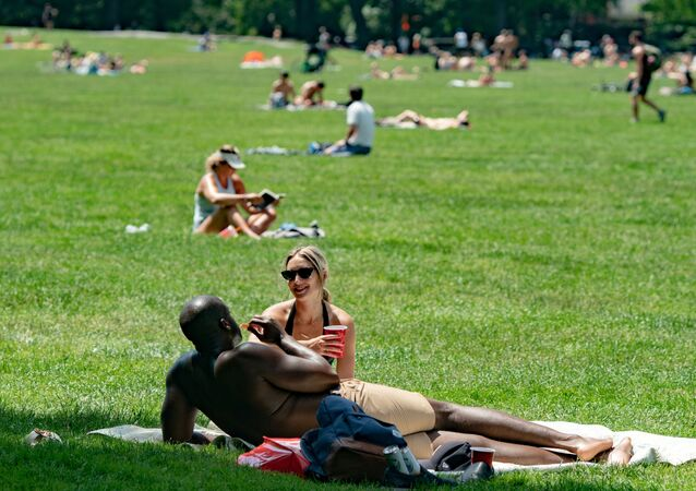 People enjoy the weather in Central Park, the day before the city starts phase two of reopening after the lockdown due to the coronavirus disease (COVID-19), in the Manhattan borough of New York City, U.S., June 21, 2020