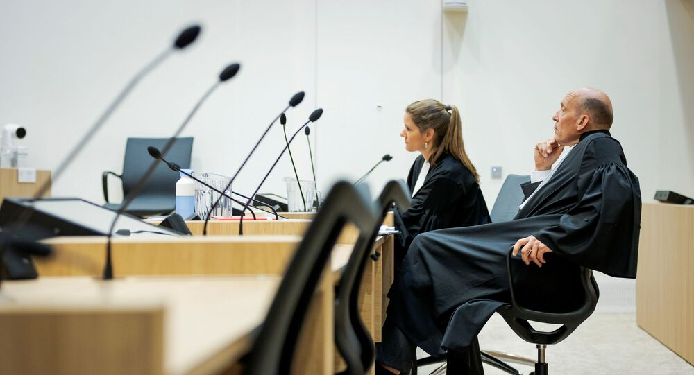 Sabine ten Doesschate and Boudewijn van Eijck, lawyers of defendant Oleg Pulatov are seen in a courtroom of The Schiphol Judicial Complex, prior to the criminal trial against four suspects in the July 2014 downing of Malaysia Airlines flight MH17, in Badhoevedorp, Netherlands, June 8, 2020.