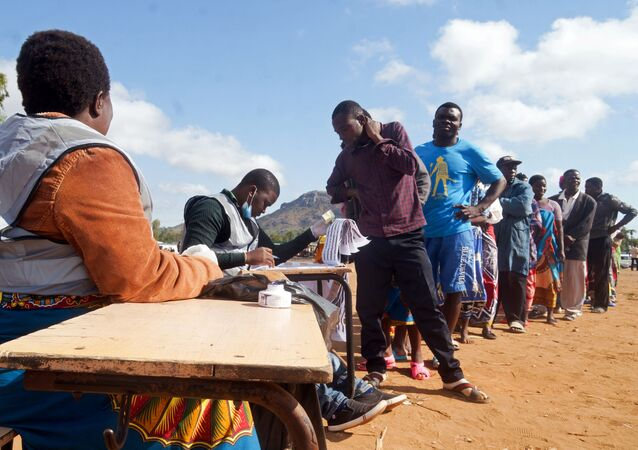 Malawians queue to vote in a re-run of a discredited presidential election