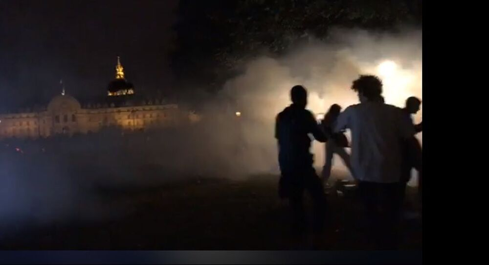 Young people gather on on the Esplanade des Invalide in Paris for a Project X party on 27-28 June