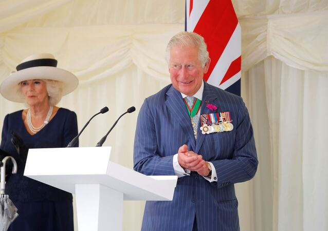 Britain's Camilla, Duchess of Cornwall and Britain's Prince Charles, Prince of Wales attend a ceremony to present the Legion d'Honneur, France's highest distinction, to London for services during WW2 at Carlton Gardens in central London on June 18, 2020