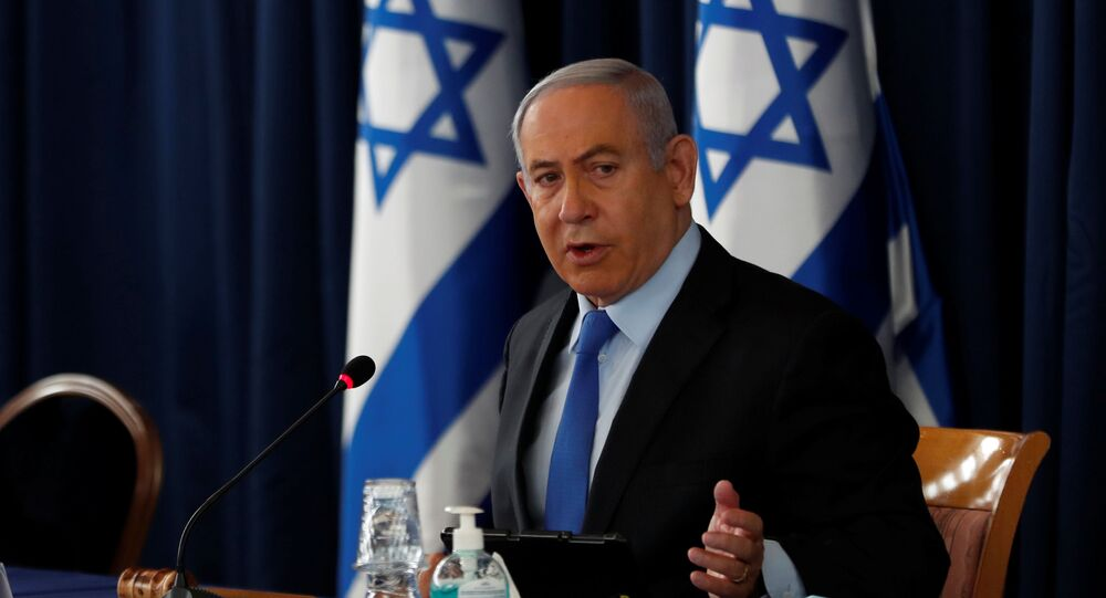 Israeli Prime Minister Benjamin Netanyahu holds the weekly cabinet meeting in Jerusalem June 28, 2020.