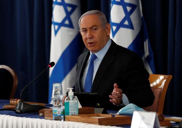 Israeli Prime Minister Benjamin Netanyahu holds the weekly cabinet meeting in Jerusalem June 28, 2020.