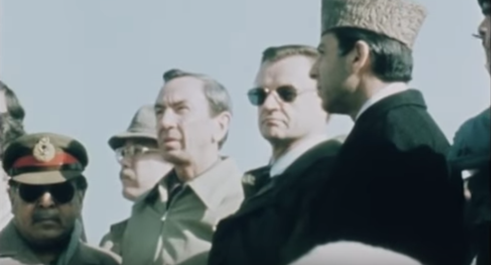 National Security Advisor Zbigniew Brzezinski's famous visit to Pakistan to speak with Afghan refugees and fighters against the pro-Soviet Afghan government. Screengrab from AP archives.
