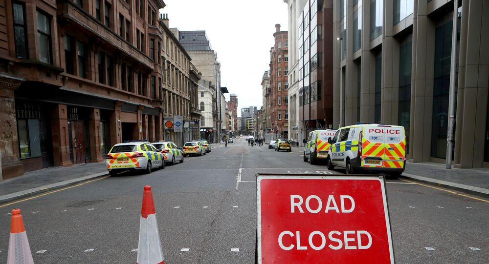 Police vehicles are seen parked near the scene of reported multiple stabbings at West George Street in Glasgow, Scotland, Britain June 27, 2020.