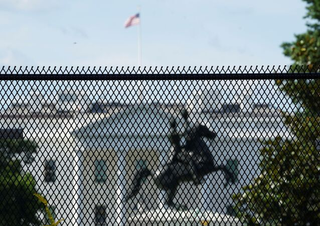 The White House and the statue of President Andrew Jackson are seen behind a  high fence reinforcing a security perimeter after racial inequality protesters attempted to tear down the statue earlier this week, in Washington, D.C., U.S., June 24, 2020.  REUTERS/Kevin Lamarque