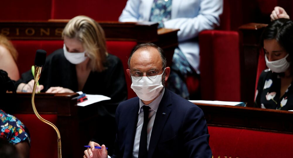 French Prime Minister Edouard Philippe, wearing a protective face mask, attends the questions to the government session at the National Assembly in Paris, France, June 23, 2020.
