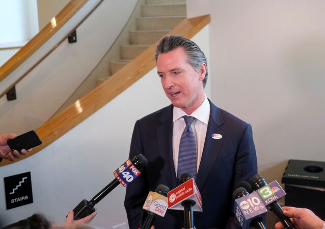 California's Governor Gavin Newsom speaks to the media after casting his vote at a voting center at The California Museum for the presidential primaries on Super Tuesday in Sacramento, CA, U.S., March 3, 2020.