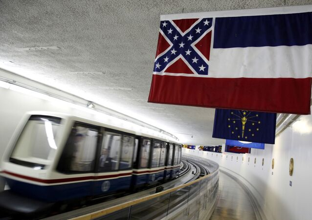 The Mississippi state flag, which incorporates the Confederate battle flag, hangs with other state flags in the subway system under the U.S. Capitol in Washington June 23, 2015.