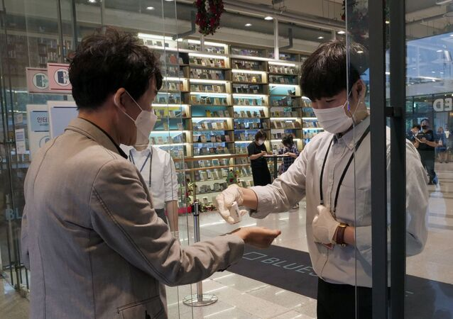 A man sanitises his hands before entering a cheater for Phantom of the Opera as the spread of the coronavirus disease (COVID-19) continues, in Seoul, South Korea, June 18, 2020.
