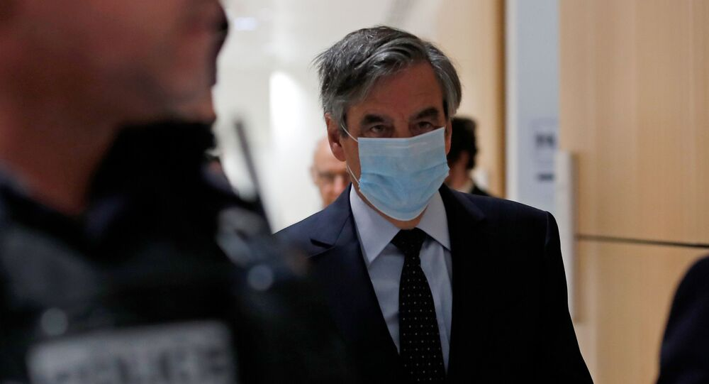 France's former prime minister Fillon gets five years for scam involving wife