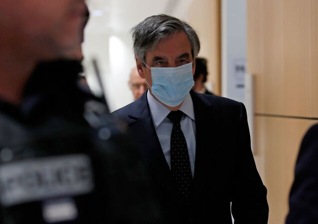 Former French prime minister Francois Fillon, wearing a protective face mask, arrives for the verdict in his trial over a fake jobs scandal at the courthouse in Paris, France, June 29, 2020
