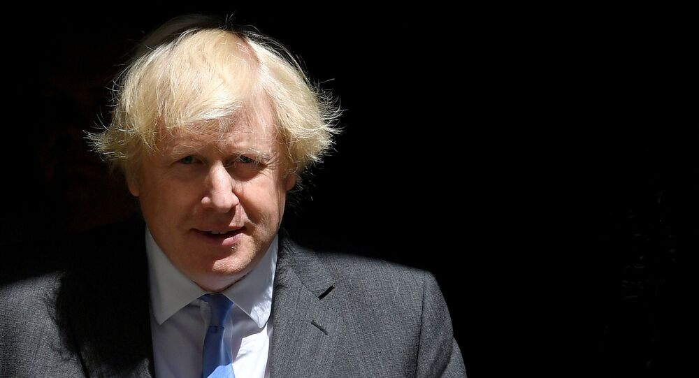 FILE PHOTO: Britain's Prime Minister Boris Johnson leaves 10 Downing Street, following the outbreak of the coronavirus disease (COVID-19), London, Britain, June 23, 2020. REUTERS/Toby Melville/File Photo