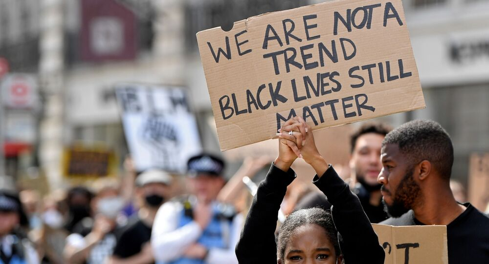 A protestors holds up a sign during a Black Lives Matter march in London, Britain, June 28, 2020