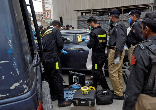 Members of the Crime Scene Unit of Karachi Police examine the site of an attack at the Pakistan Stock Exchange entrance in Karachi June 29, 2020. REUTERS/Akhtar Soomro
