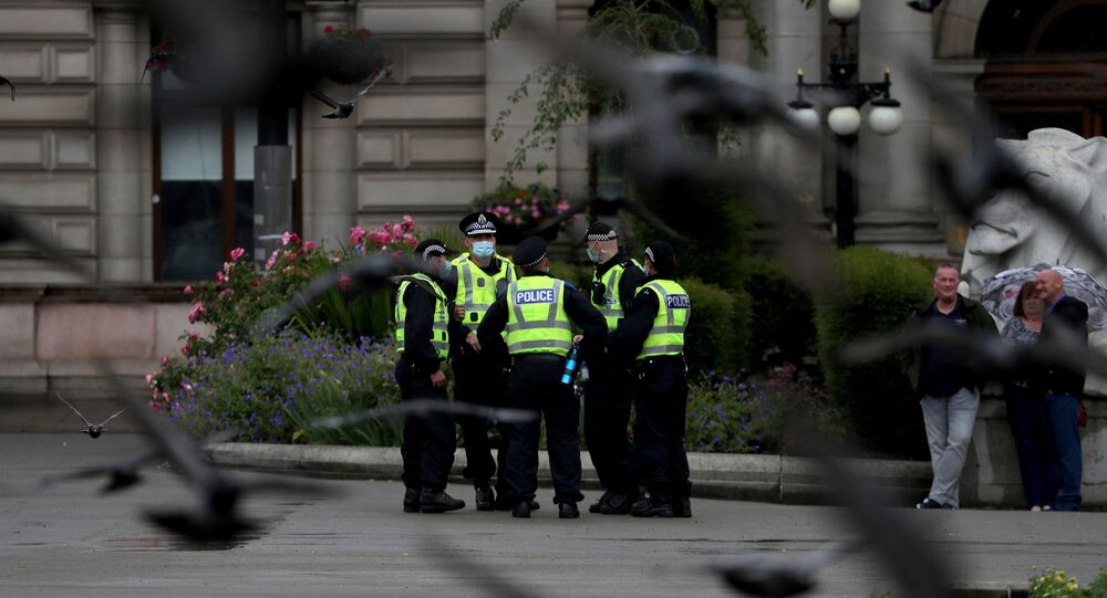 Police officers stand at George Square in Glasgow, Scotland, Britain June 27, 2020