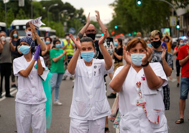 Staff members from Nino Jesus hospital and other people block the street during a protest against the privatisation of public health, amid the coronavirus disease (COVID-19) outbreak, in Madrid, Spain, June 1, 2020.