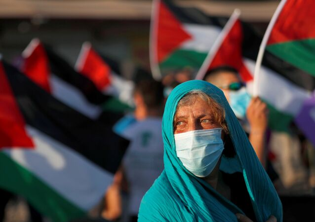 Peace activists take part in a protest against Israel's plan to annex parts of the Israeli-occupied West Bank, in the Palestinian town of Jericho June 27, 2020