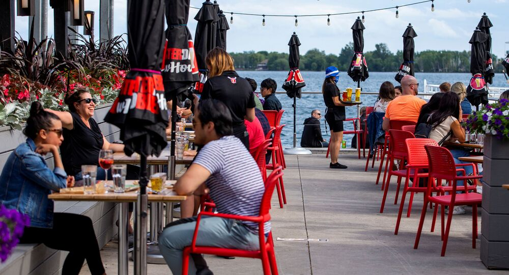People enjoy drinks and food at Amsterdam Brewhouse's patio, as the provincial phase 2 of reopening from the coronavirus disease (COVID-19) restrictions begins in Toronto, Ontario, Canada June 24, 2020.