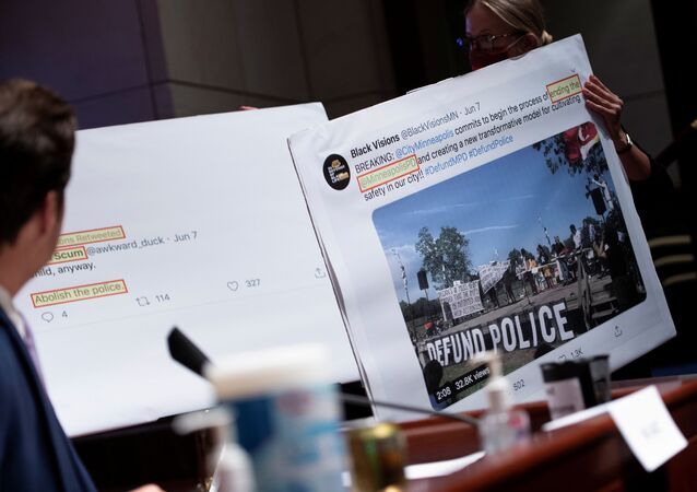 Tweets about defunding the police are shown during the House Judiciary Committee hearing on Policing Practices and Law Enforcement Accountability at the U.S. Capitol in Washington, DC, U.S., June 10, 2020.