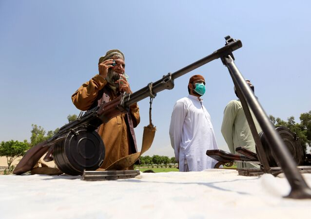 Members of the Taliban hand over their weapons and join the Afghan government's reconciliation and reintegration programme in Jalalabad, Afghanistan, 25 June 2020