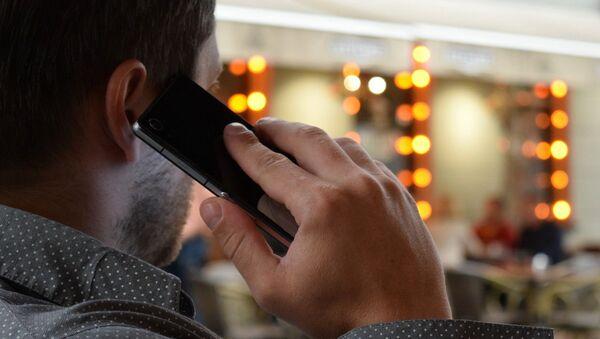 Man with phone - Sputnik International