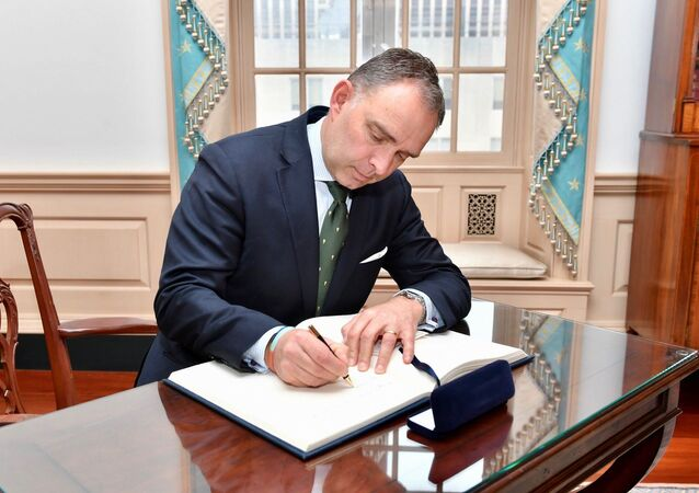 United Kingdom National Security Advisor Mark Sedwill signs Secretary Pompeo's guestbook before their meeting at the U.S. Department of State in Washington, D.C. on March 7, 2019