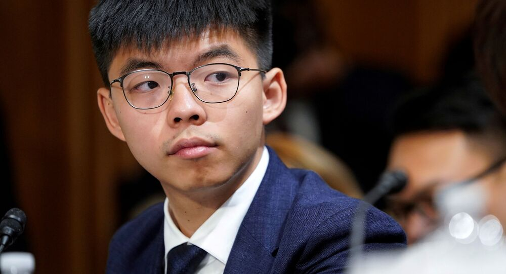 Joshua Wong, secretary-general of Hong Kong's pro-democracy Demosisto party and leader of the Umbrella Movement, listens to testimony at a Congressional-Executive Commission on China (CECC) hearing on Capitol Hill in Washington, U.S., September 17, 2019