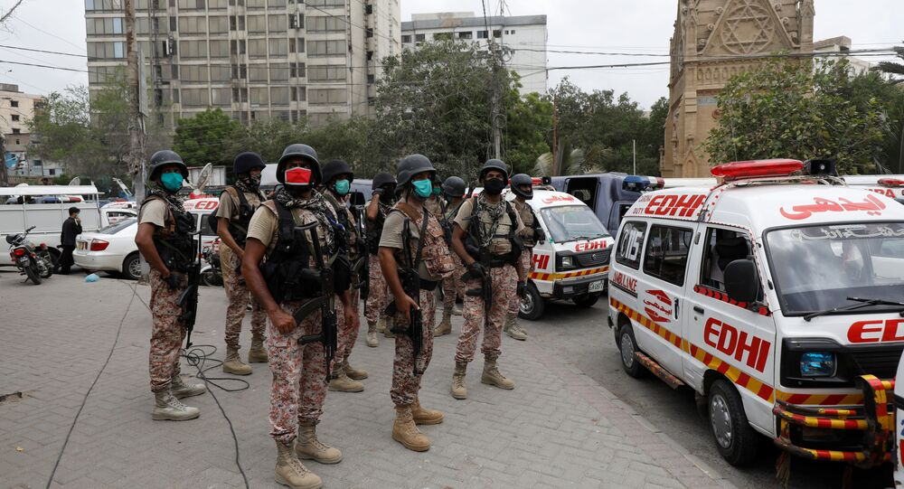 Paramilitary soldiers stand guard at the site of an attack at the Pakistan Stock Exchange in Karachi June 29, 2020